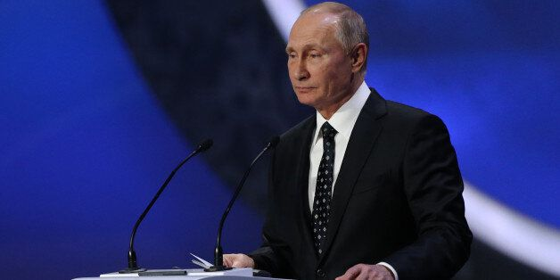 Russia's President Vladimir Putin speaks to the audience before the Final Draw for the 2018 FIFA World...