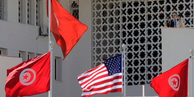 Tunisian and a United States flags flying at the Tunisian Foreign Ministry, for the visit of the US Secretary...