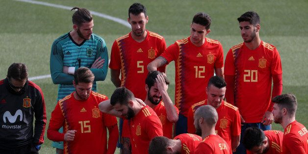 Spain's national team player Marc Bartra touches teammate Isco's hair as they get ready to pose wearing...