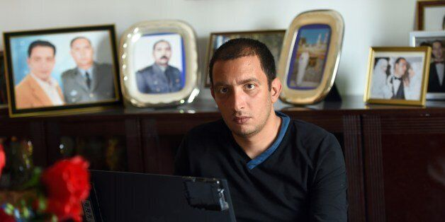 Tunisian blogger Yassine Ayari works on his laptop at home on April 17, 2015 in Tunis. Tunisian authorities...