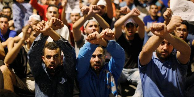 Moroccans take part in a demonstration against official abuses and corruption in the town of Al-Hoceima,...