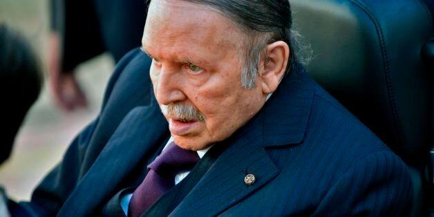 Algerian President Abdelaziz Bouteflika is seen heading to vote at a polling station in Algiers on November...