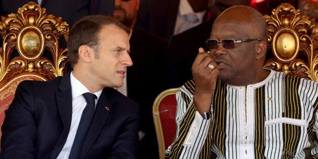 French President Emmanuel Macron and Burkina Faso's President Roch Marc Christian Kabore attend the inauguration...