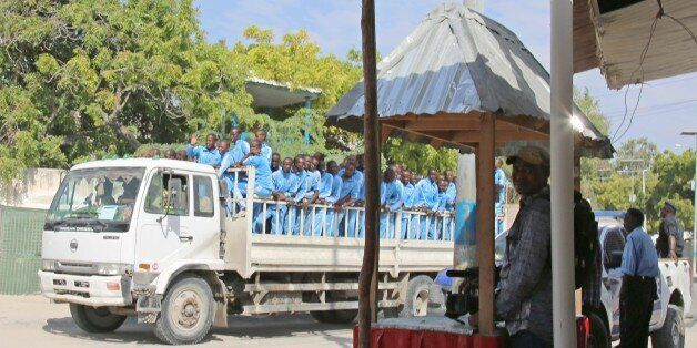 MOGADISHU, SOMALIA - DECEMBER 14: Somalian police cadets on a truck are seen at the scene after a suicide...