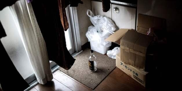 This picture taken on June 21, 2017, shows a bottle of whisky in the kitchen of a woman who died alone...