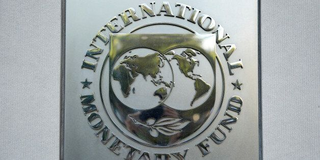 International Monetary Fund (IMF) logo is seen at the IMF headquarters building during the IMF/World...