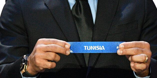 Brazil's former defender Cafu displays the slip of Tunisia during the Final Draw for the 2018 FIFA World...