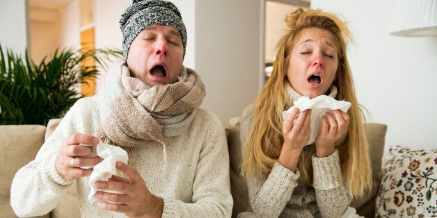 Sick couple catch cold. Man and woman sneezing, coughing. People got flu, having runny