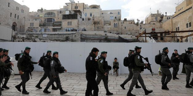 Israeli border police patrol at the plaza of the Western Wall, Judaism's holiest prayer site, in Jerusalem's...