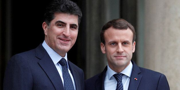 French President Emmanuel Macron welcomes Kurdish region's Prime Minister Nechirvan Barzani at the Elysee...