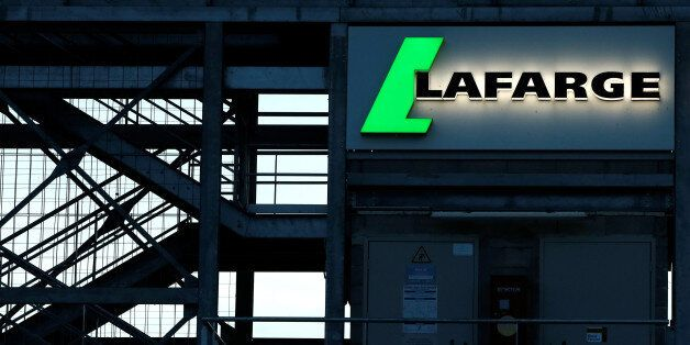 The logo of the French building materials maker Lafarge is seen in Paris, France May 22, 2017. Picture...