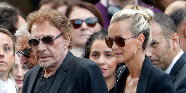 French singer and actor Johnny Hallyday (L) and his wife Laeticia attend the funeral ceremony of late...