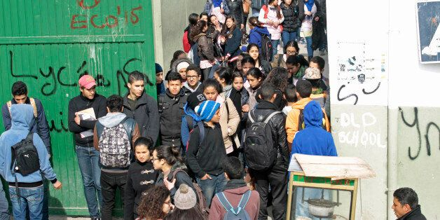Students walk out of Sadiki high school as teachers go on strike in Tunis March 2, 2015. Tunisia's main...