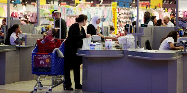 Customers shop at a supermarket in Tunis November 12, 2012. Tunisia's central bank has clamped down on...