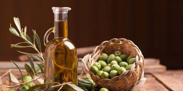 Olive oil and olives on wooden rustic