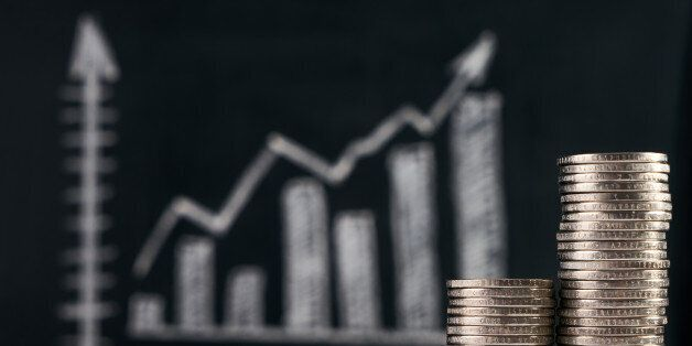 Business and growing finance concept with graph and coins on