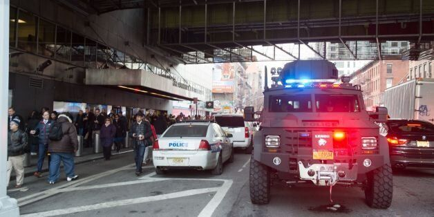 Police and other first responders respond to a reported explosion at the Port Authority Bus Terminal...