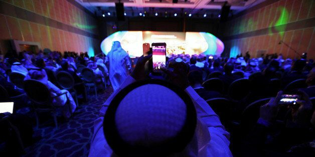 A saudi national films the inauguration with his smart phone at Saudi-US CEO Forum 2017 ahead of the...