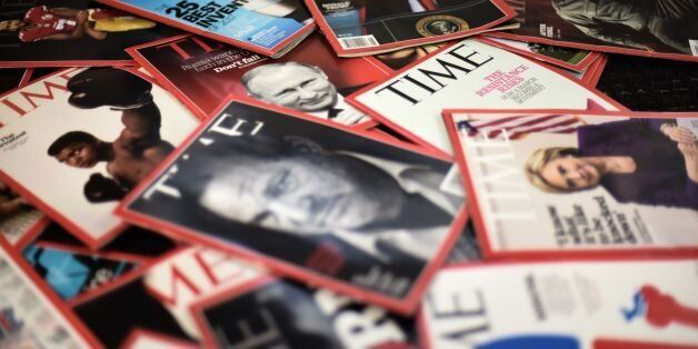 Time magazine copies are dispalyed on a table in Washgington on November 27, 2017. Time Inc. is selling...