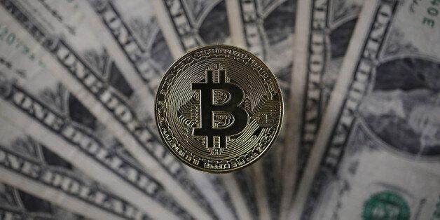 LONDON, ENGLAND - DECEMBER 07: A visual representation of the digital Cryptocurrency, Bitcoin alongside...
