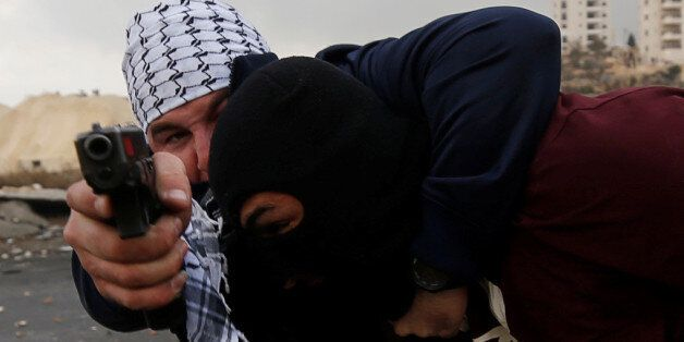 Undercover Israeli security personnel detain a Palestinian demonstrator during clashes at a protest against...