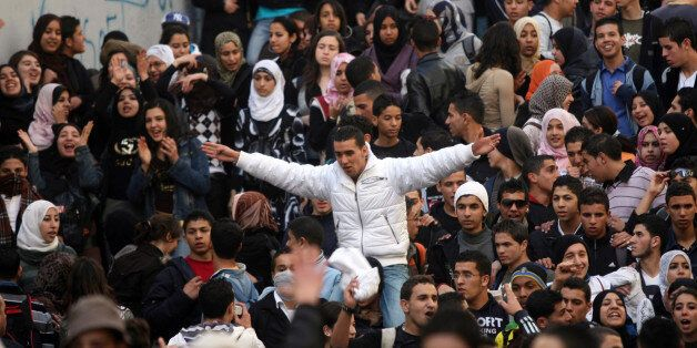Algerian secondary schools students shout slogans during a protest held in front of a local school in...
