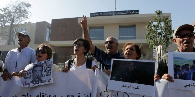 Relatives of the leaders of Morocco's Hirak protest movement shout slogan outside the Casablanca tribunal,...