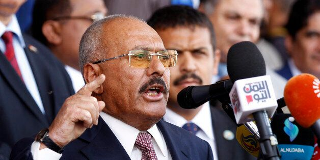 Yemen's ex-president Ali Abdullah Saleh gives a speech addressing his supporters during a rally as his...