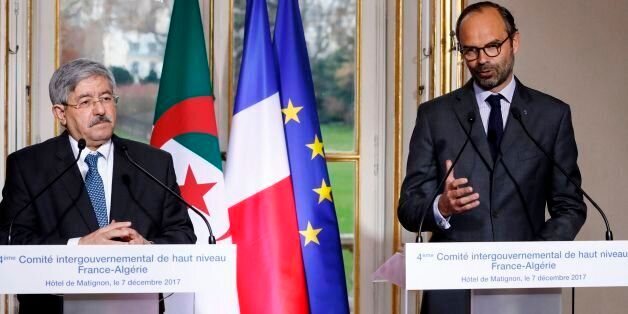 French Prime Minister Edouard Philippe (R) and his Algerian counterpart Ahmed Ouyahia hold a joint press...