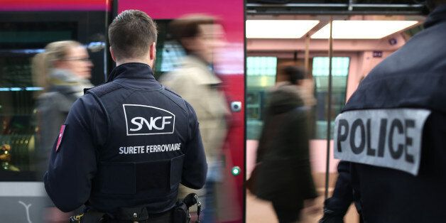 Rail security guards from the SNCF (French state-owned railway company) and French police patrol inside...
