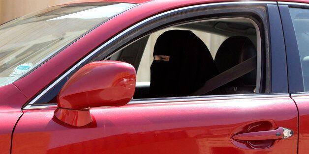 A woman drives a car in Saudi Arabia October 22, 2013. A conservative Saudi Arabian cleric has said women...
