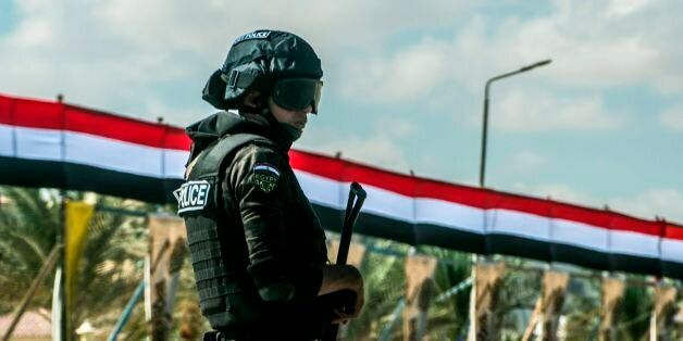 A picture taken on October 21, 2017 shows an Egyptian policeman standing guard in the new city of el-Alamien,...