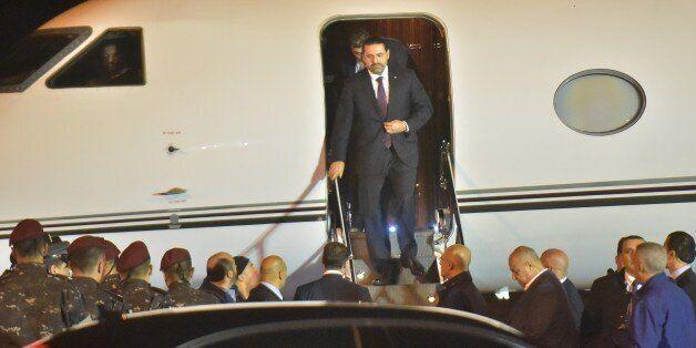 Lebanese Prime Minister Saad Hariri (C) arrives at Beirut International Airport on November 21, 2017.Lebanon's...