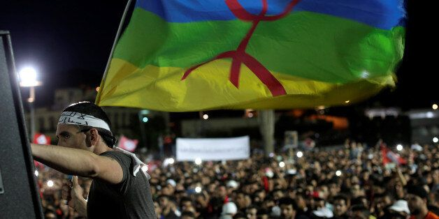 Moroccans gather during a demonstration in the northern town of Al-Hoceima to protest against injustice...