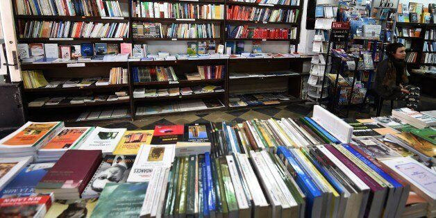 Books are exposed on shelves at the Ijtihed bookshop in the Algerian capital Algiers on February 16,...