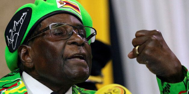 Zimbabwean President Robert Mugabe addresses a meeting of his ruling ZANU PF party's youth league in...