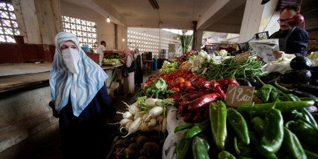 A woman shops at a vegetable and fruit market in Algiers, Algeria October 15, 2017. Picture taken October...