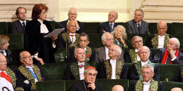 Assia Djebar (standing) delivers her acceptance speech at the Academie Francaise in Paris June 22, 2006....