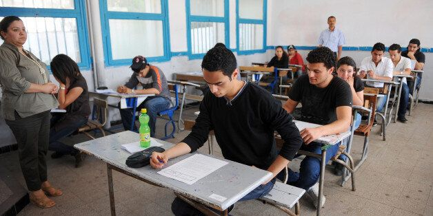 Tunisian students take the baccalaureat (high school graduation exam) exam on June 9, 2011 in Tunis....