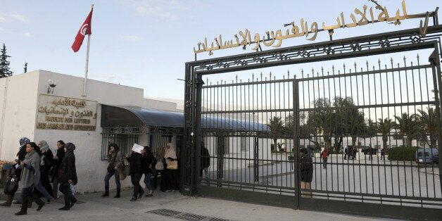 Students of the Faculty of Arts and letters in Manuba leave the campus on January 18, 2012 in Tunis....