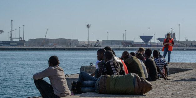 Migrants recovering at the Malaga harbor, Spain, on 9 October 2017 after being rescued by the Spanish...