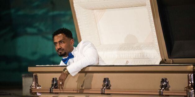 Ethiopian film director Zekarias Mesfin surprises audience by appearing from inside a coffin on the stage...
