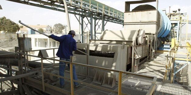A worker works at a phosphate mine in Metlaoui, Tunisia April 6, 2012. Phosphate production at Tunisia's...