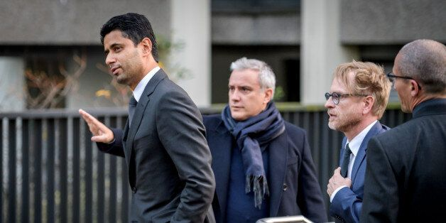 Paris Saint-Germain president and beIN Media chief Nasser al-Khelaifi (L) leaves the office of Swiss...