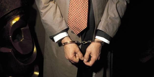 Person under arrest with handcuffs Detail of the handcuffed hands of a man under arrest (Photo by Matias...
