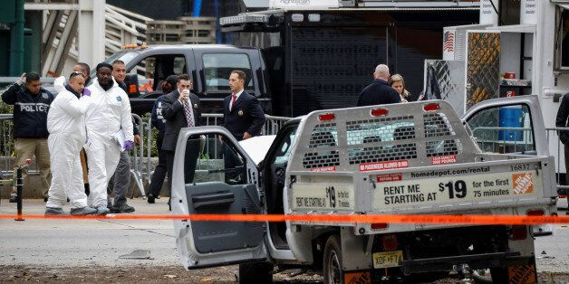 Law enforcement officials investigate a pickup truck used in an attack on the West Side Highway in lower...