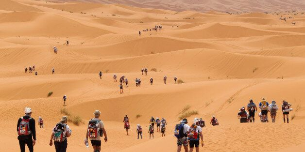 Competitors cross the dunes of Merzouga, the hightest of Morocco , some 300 kms south of Ouarzazate,...