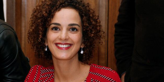 Moroccan-French author Leila Slimani reacts at the Drouant restaurant after she received the French literary...