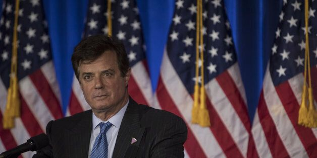 FILE: Paul Manafort, a Trump campaign worker, stands on stage before Donald Trump, presumptive Republican...