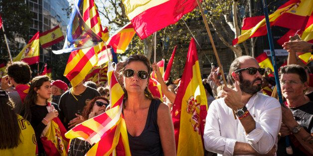 BARCELONA, SPAIN - OCTOBER 29: Spanish government supporters wave Spanish flags and carry banners during...